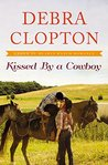 Kissed by a Cowboy (Four of Hearts Ranch #3)
